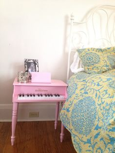 Preppy Apartment Decorating - Cute Thrift Store Find! Re-purposed toy piano into a fun & whimsical bedside table.