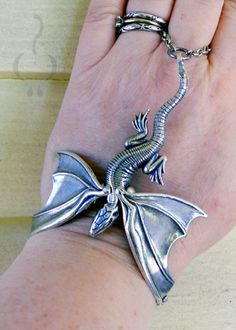 It's a HANDRAGON!  Silver over brass, cold connected.