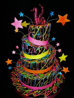 Neon Colored Topsy Turvy Sweet Sixteen  Cake. This cake was a big hit and has been made in different sizes. It can be made to celebrate almost any event.