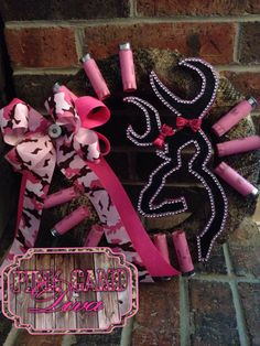 """14"""" BLING Browning inspired wreath with lots of PINK spent shotgun shells & a PINK CAMO DIVA style ribbon bow always with a 12g polished center! This one is for the true Pink Camo Diva hunter! Email orders or inquires to pinkcamodivallc@gmail.com"""
