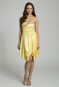 Take over the dance floor in this strapless silky knit dress.  It has a long gathered bodice to accentuate those curves and a pearl detail along the sweetheart trim.  You'll walk with grace as the tiered flowy skirt sways.  You can wear it as a Guest of Wedding Dress, Homecoming Dress, a Day-into-Evening Dress, or to a dance party night or any dressy gathering or affair. Dress it up with high heel rhinestone sandals, an 8 row stretch rhinestone bracelet and a pleated satin crepe handbag w...