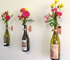 Wine bottles recycled into beautiful wall vases