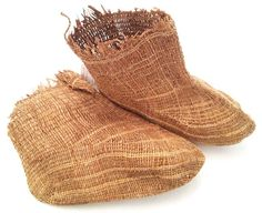 Pair of grass socks of the Ingalik or Aleut of the Subarctic, Yukon River (Alaska made of rye grass). These were worn inside of a seal or other boot to keep the feet dry. Late 19th century.
