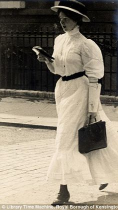 "Wonderful series of photos of women walking in London and Paris. This was taken 30th June 1908 of a ""shopgirl"" reading. Note the sleeve protectors."