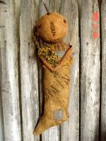 Prim Fall Decor...grungy cloth pumpkinhead doll...in a grain sack...on a picket fence.