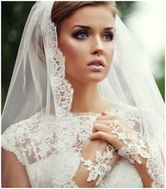 beautiful veil, makeup, and lace gloves