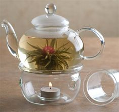 glass teapot with warmer. My blooming tea from Teavana would be perfect in this. I want to have tea party lol!