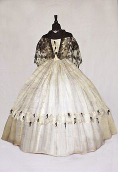 gauze ball gown with lace and ribbons  1860