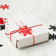 Acrylic snowflake gift decorations in black, red tint, clear and ice