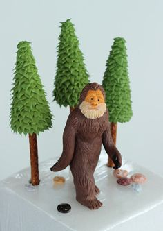 This is a Bigfoot cake topper and some trees that I made for a friend. Bigfoot is made from modeling chocolate and the trees are pretzel sti...