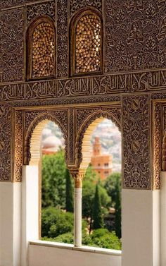 """A view of the Alhambra Palace, in Granada, Andalusia. The calligraphy reads """"و لا غالب إلا الله"""" - """"There is no victor besides Allah""""."""