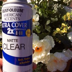 Spray clear enamel matte finish on your cemetery flower to make them last longer in the elements.