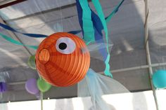 Another species of paper lantern fish. Great party decoration! It's a paper lantern with some tulle for the tails and fins and paper cut-outs for the eyes. Shop 50+ paper lantern colors online at http://www.partylights.com/Lanterns/Lanterns-by-Color.