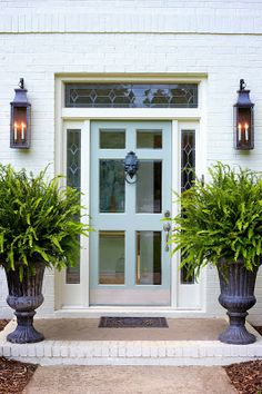 Door, white brick, sconces. Photo: Marianne Strong Interiors.