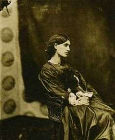 """Photograph by John Robert Parsons, taken in 1865 at the London home of Dante Gabriel Rossetti, who invited him to photograph his favorite model (& lover), Jane Burden. Jane was also married to William Morris. ___ Part of an exhibition entitled, """"A Ballad of Love and Death: Pre-Raphaelite Photography in Great Britain, 1848-1875"""" at Musee d'Orsay, Mar 3- May 29, 2011"""