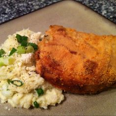 Low carb - Parmesan Dijon crusted pork chops with horseradish- chive cauliflower mash  Www.peaceloveandlowcarb.com  http://facebook.com/pages/Peace-Love-and-Low-Carb/167748223291784