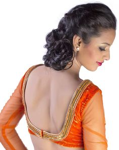 A flame orange velvet blouse with sheer net full sleeve, embellished with cut pipe and bead border.