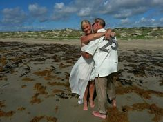 Beach wedding for 25th year anniversary vow renewal