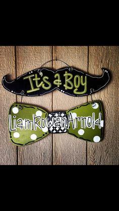 It's a boy mustache door hanger!