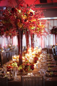 These floral arrangements are lovely for a fall or red themed wedding http://chery1nguyen.blogspot.ca/2010/12/spotlight-karen-tran-florals.html