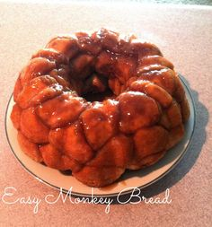 Monkey Bread •1/2 Cup sugar  •1 teaspoon cinnamon  •2 cans refrigerated buttermilk biscuits  •1 stick of melted butter or margarine •I cup packed brown sugar 350 for 30 mins