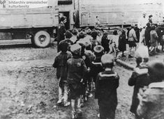 Children of the Lodz Ghetto are lined up and loaded onto trucks to be taken to the Extermination Camp at Chelmno.