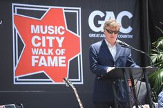Musician Steve Winwood addresses the crowd during his and Bob Babbitt's Music City Walk of Fame Induction at Walk of Fame Park on June 5, 2012 in Nashville