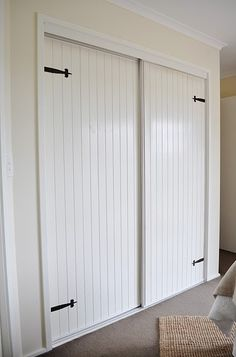 Brilliant- textured vinyl beadboard wallpaper on doors to update hollow core doors. Very country cottage looking.