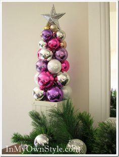 Made out of ornaments strung on a knitting needle!