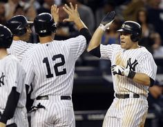 GAME 54: Tuesday, June 5, 2012 - New York Yankees' Russell Martin, right, is greeted by teammates Eric Chavez, center, and Raul Ibanez after he hit a grand slam during the fourth inning of a baseball game against the Tampa Bay Rays at Yankee Stadium in New York. (AP Photo/Seth Wenig)