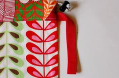 How to store your baby carrier. Cute, functional storage for babywearing. Baby carrier bag by Red Charlotte. African fabric. ERGObaby.