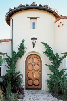 For a classic Mission-style look, consider the eight-panel radius-top Model A1308 prehung door, with Knotty Alder grain, from the Aurora Custom Fiberglass Collection, starting at $4,500; jeld-wen.com | thisoldhouse.com