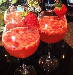 Strawberry Sangria 1 bottle of Moscato Wine 1 frozen raspberry lemonade concentrate 3 cans of sierra mist soda and a bunch of strawberries cut up.  Mix it all together and let make a happy punch. YUM! You can see that looks delish right?