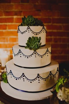 black and white cake with succulents, photo by Sloan Photographers http://ruffledblog.com/glam-carondelet-house-wedding #cakes #weddingcake #succulents