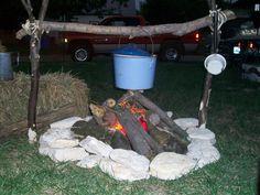Fake campfire. Flashlights lit under red cellophane make for life-like fire.