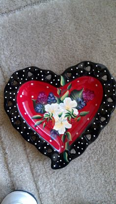 Heart shaped plate with flowers and strawberries.