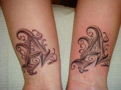 dillon letter tattoo via Flickr.