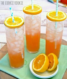 What a great idea! Set an orange slice & straw on top of a glass for a lid.