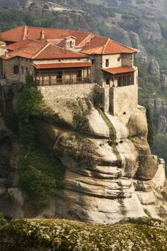 TRAVEL LOCATION TIP -- The extraordinary MEDIEVAL MONASTERIES of METERORA, GREECE, sit atop pinnacles of spired, mountain peaks!  (Image by Dr. Joseph T. McGinn) -- Get travel tips and see a published slideshow of the medieval monasteries of Meteora at http://www.examiner.com/article/experience-medieval-monasteries-meteora-greece
