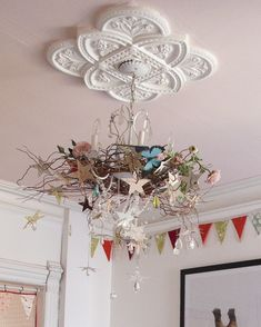 Crazy, whimsical magpie nest of a chandelier! And that ceiling medallion... I love everything about this!