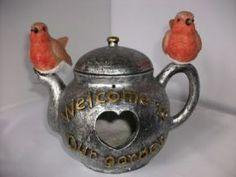 tea-kettle-bird-house-robin-garden-ornament-232-p[ekm]288x216[ekm].jpg 288×216 pixels