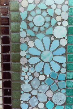 Mosaic blue tiles into flowers
