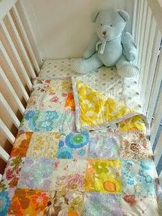 vintage sheet baby quilt. Oh my stars. I just got the best idea: You know all those hand me down blankets from your youth that you want to share with your baby but they're all frayed & stuff? Make 'em into a quilt. BEST!