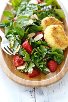 Purslane and Pickled Strawberry Salad with Fried Goat Cheese from --the herbed vinagarette looks quite tasty