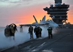 An F/A-18 Super Hornet is directed onto the catapult on the flight deck of the aircraft carrier USS Theodore Roosevelt. The Super Hornet is an attack aircraft as well as a fighter. #Navy #USNavy #AmericasNavy navy.com