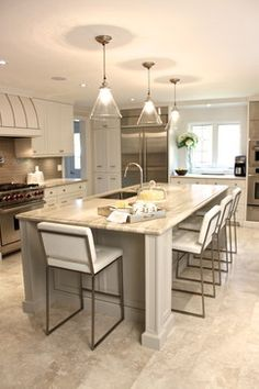 Neutral kitchen palette; porcelain tile floor