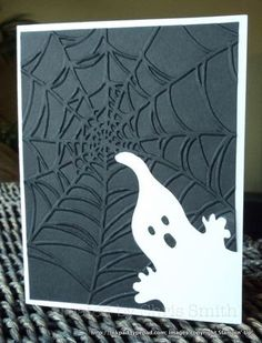 handmade Halloween card .. black and white ...graphic clean and simple look ... embossing folder spider web covers black background ... white die cut ghost looms from the corner ... great card!