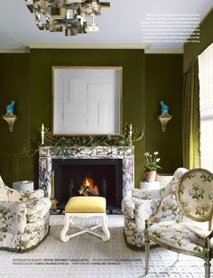 Colefax & Fowler's bowood print enveloped by wonderful green walls.