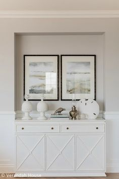 Notice how nicely a black frame goes with a soft gray wall and white console