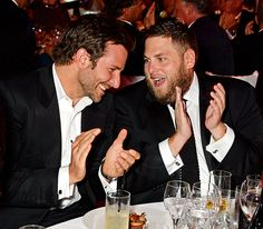 Bradley Cooper listens to a similarly fuzzy-faced Jonah Hill during the GQ Men of the Year Awards in London